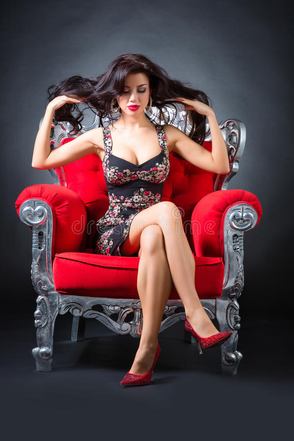 Young woman in a red chair. Retro style stock images