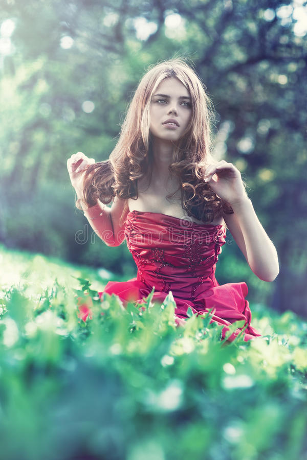 Download Young woman in red dress stock image. Image of sitting - 14913311