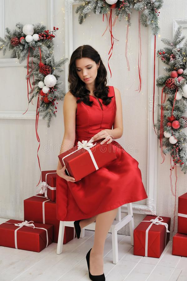 Attractive young woman with a christmas gift stock photo