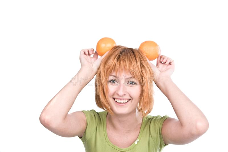Download The Young Woman With Red Hair Holds Two Oranges Stock Image - Image: 6185575