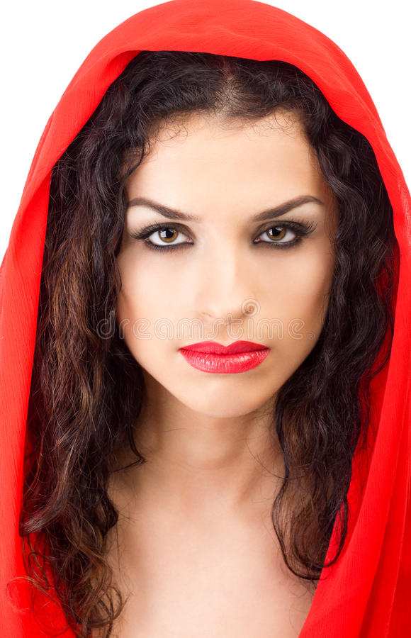 Young woman in red hood with red lips. Portrait of a beautiful brunette with red lips isolated on white stock photo