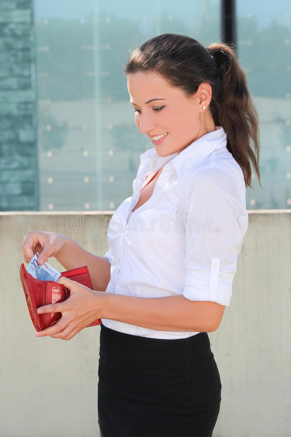 Young woman with red leather wallet