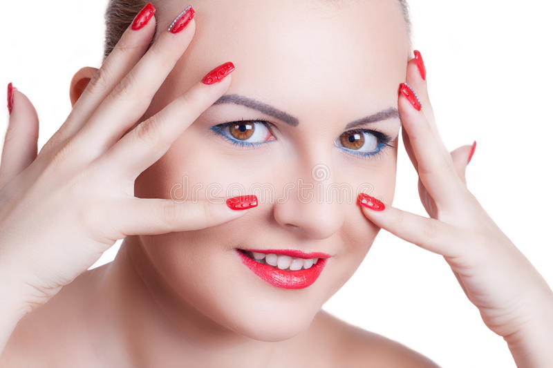 Young woman with red manicure and red lipstick royalty free stock photos