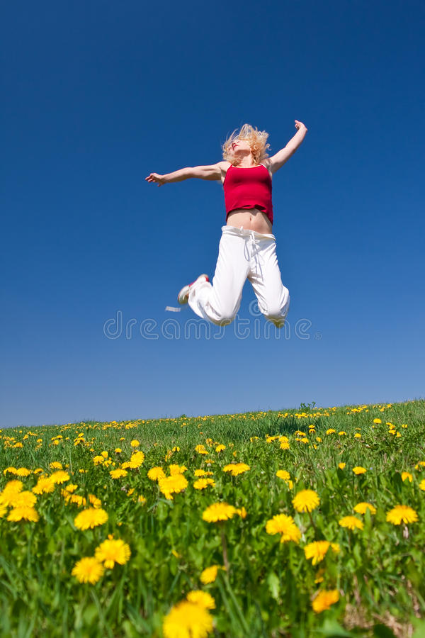 Young woman in red outfit having fun on meadow stock photos
