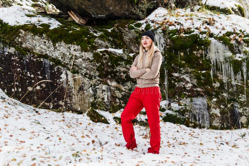 Young woman in red pants stock photos