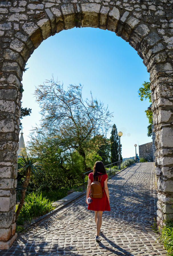 A young woman in a red summer dress stock photography