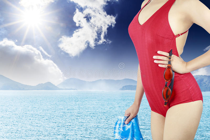 Young woman with red swimsuit
