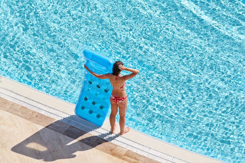 Download Young Woman In Red Swimsuit Stands On Poolside Stock Image - Image of mattress, girl: 32223923