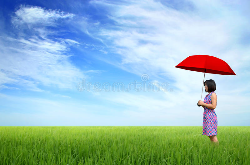 Young woman with red umbrella royalty free stock photo