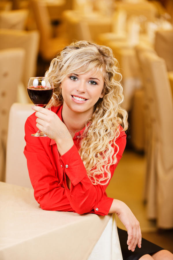 Download Young woman with red wine stock photo. Image of haired - 16838492