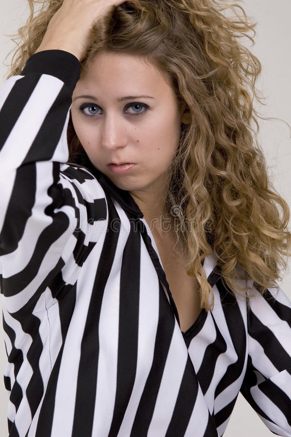 Young woman in referee striped shirt stock image