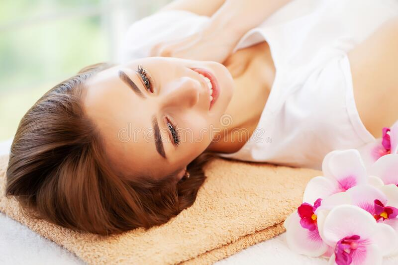 Young woman on rejuvenating facial massage in beauty studio stock photography