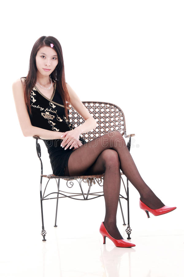 Young woman relaxing. On the rattan chair,isolated on white royalty free stock photos