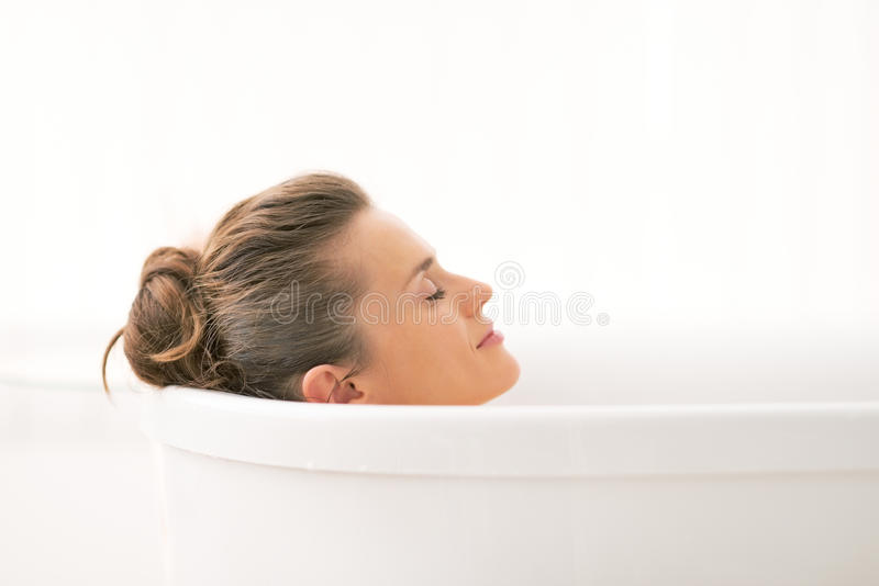 Young Woman Relaxing In Bathtub Stock Photo