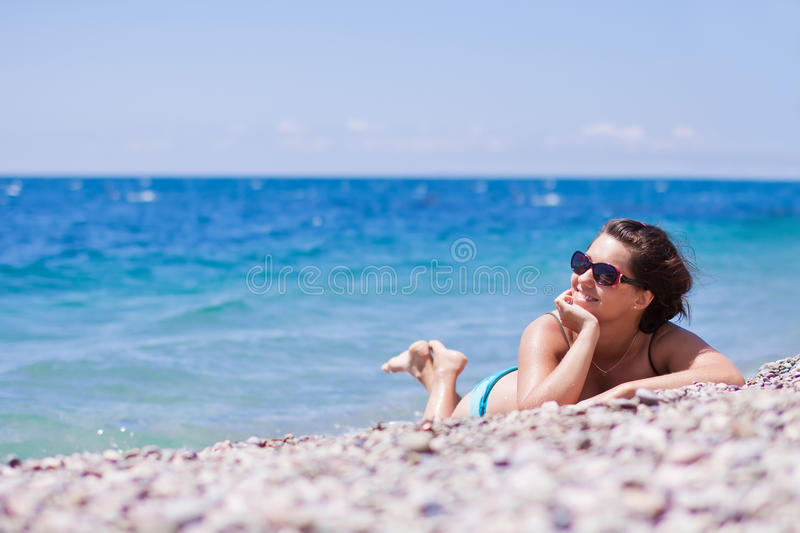 Download Young Woman Relaxing On The Beach Royalty Free Stock Photography - Image: 19259947