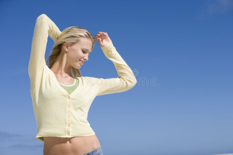 Young woman relaxing at beach royalty free stock photography