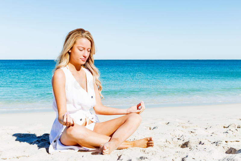 Young woman relaxing on the beach royalty free stock photo