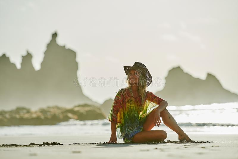 Young woman relaxing on the beach in summer day stock photo