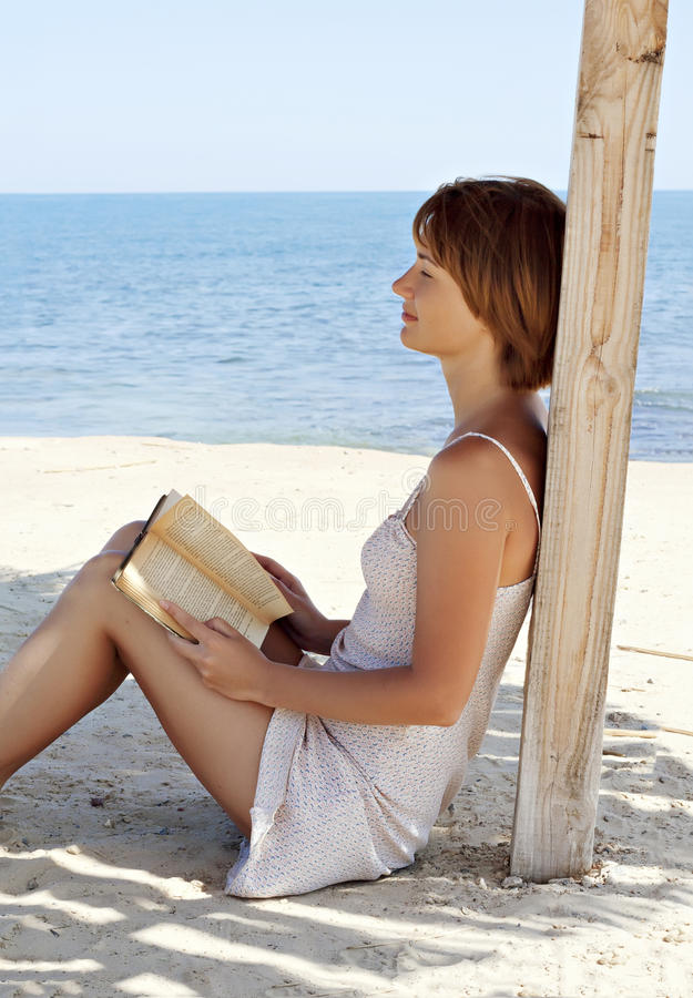 Download Young Woman Relaxing With A Book Near The Sea Stock Photo - Image: 15155008