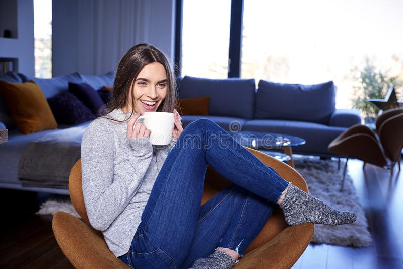 Young woman relaxing at home and having a cup of tea stock images