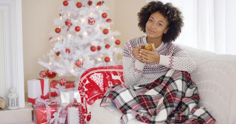 Young woman relaxing at home over Christmas stock photos