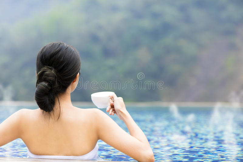 Young woman relaxing in hot springs stock photo