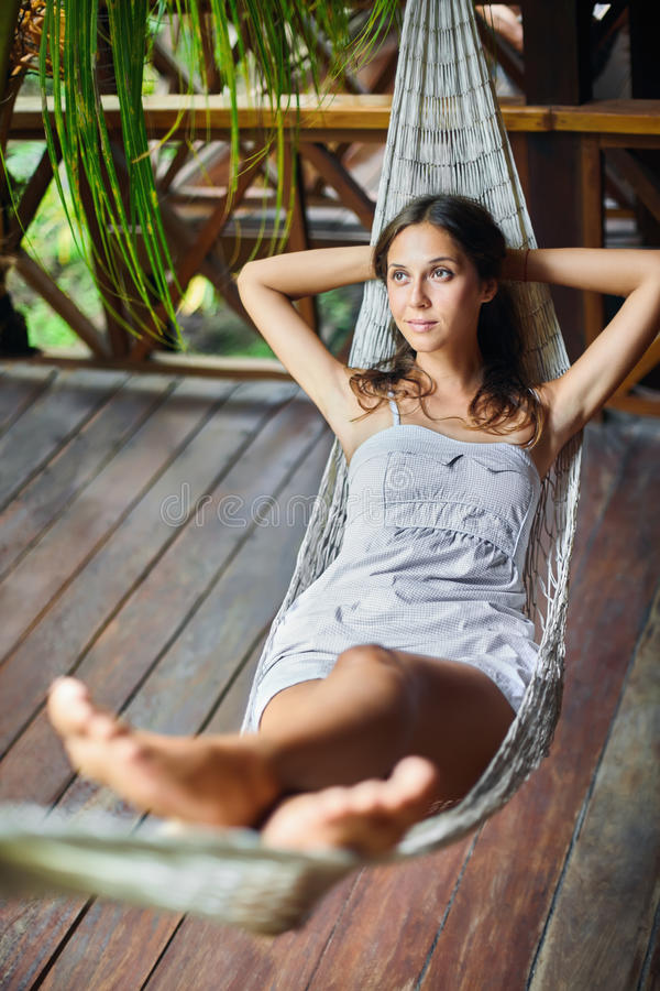 Free Young Woman Relaxing In Hammock In A Tropical Resort Stock Photography - 69045782