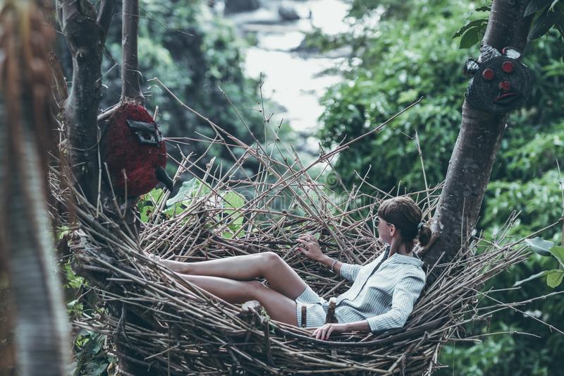 Young woman relaxing in the jungle of Bali island. Indonesia stock images