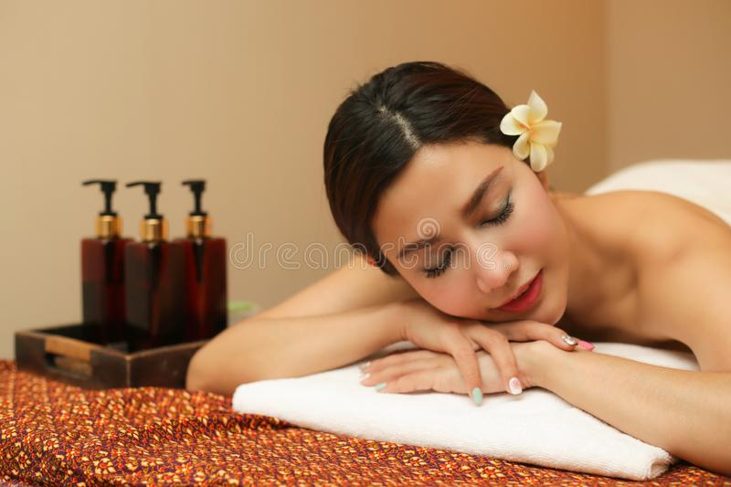 Young woman relaxing in the massage spa stock photography