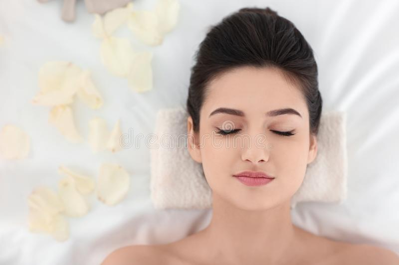 Young woman relaxing on massage table at spa salon, top view stock photos