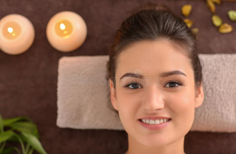 Young woman relaxing on massage table at spa salon, top view stock image
