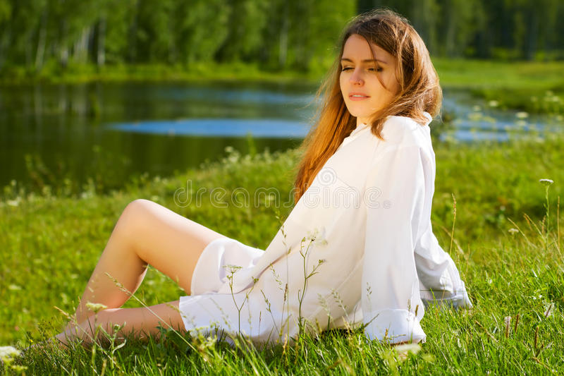 Young Woman Relaxing On Nature. Royalty Free Stock Images