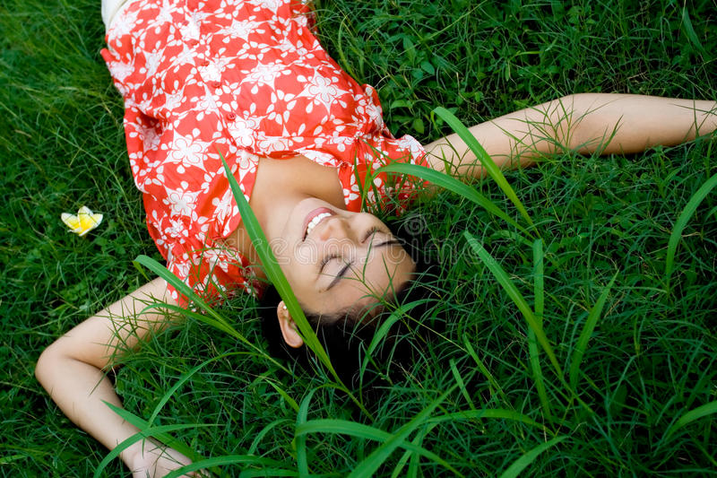 Young woman relaxing in nature royalty free stock photography