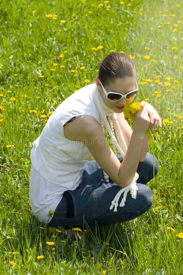 Young woman relaxing in nature holding flowers