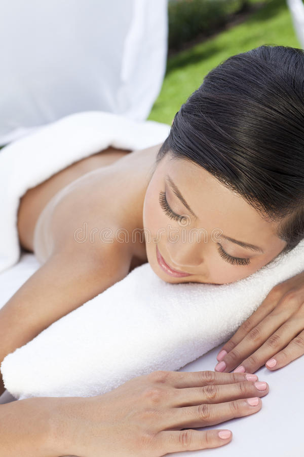 A Young Woman Relaxing Outside At Health Spa Stock Photo