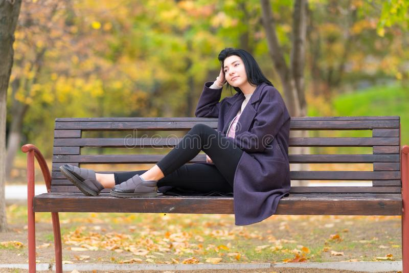 Young woman relaxing in a park thinking deeply. stock images