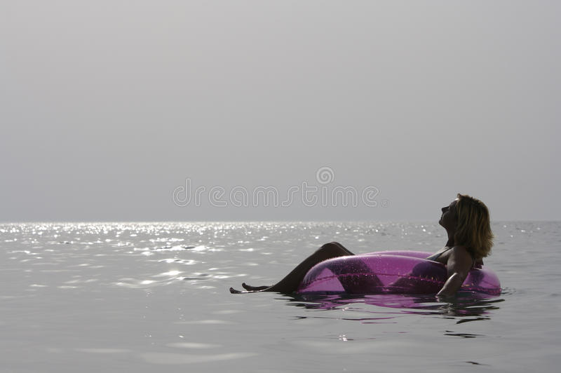 Young woman relaxing in the sea. stock images