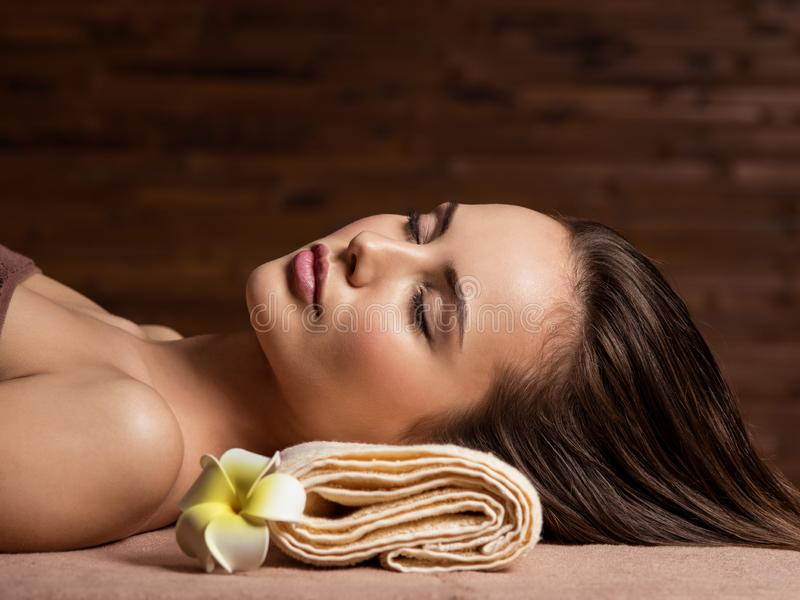 young woman relaxing in a spa salon. Beauty treatment. Spa salon royalty free stock photography