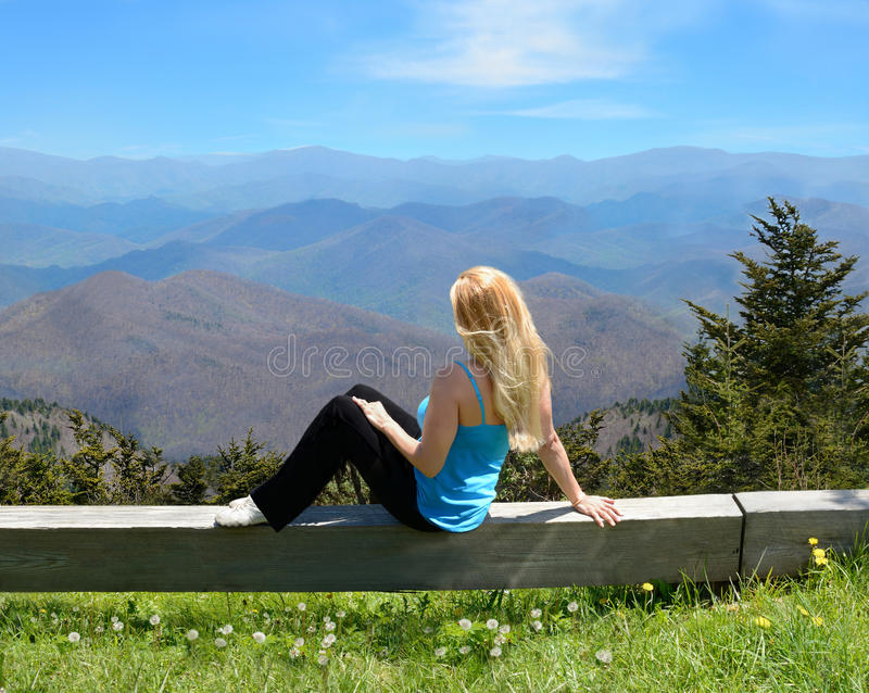 Download Young Woman Relaxing On The Top Of The Mountain. Stock Photo - Image of forest, energy: 55954530