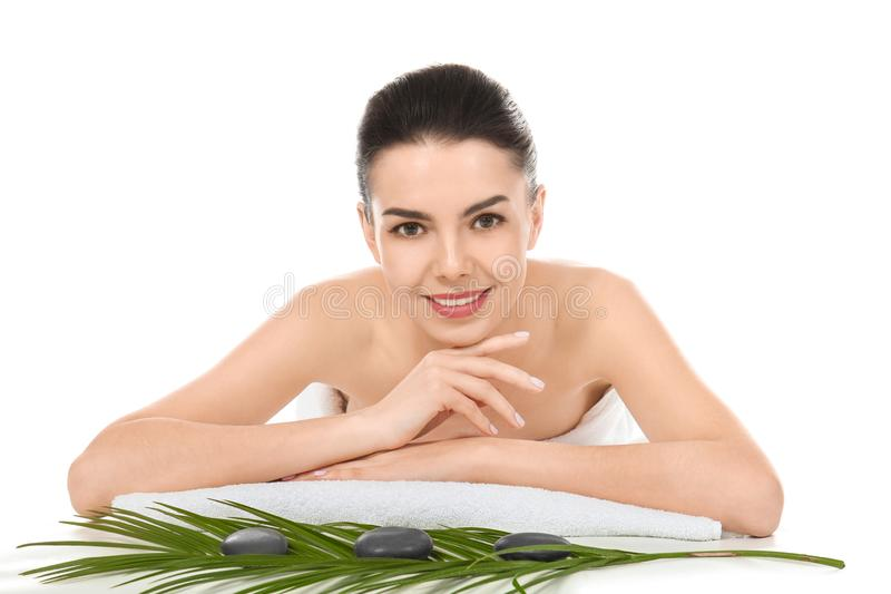 Young woman relaxing on white background. Spa treatment stock photos