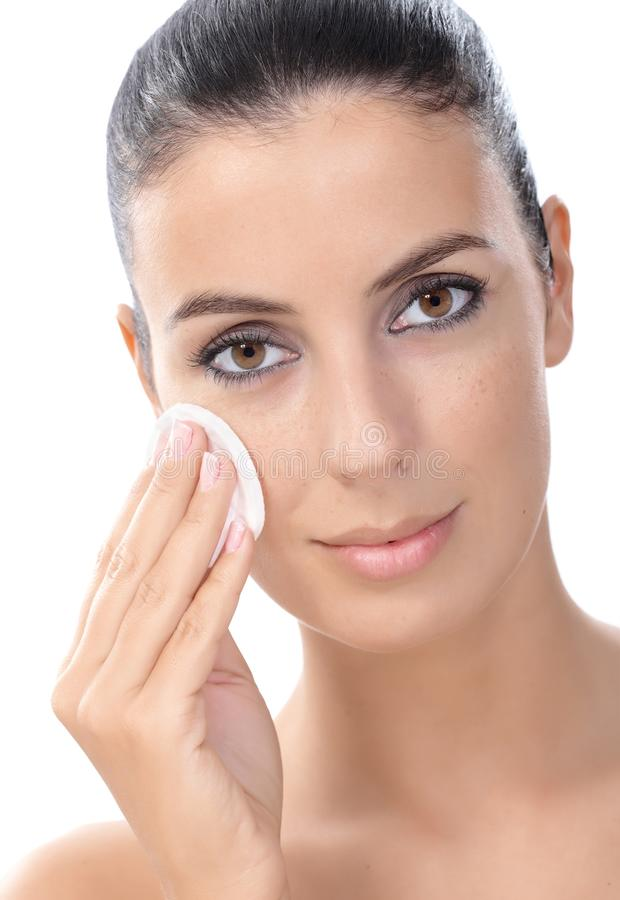 Young Woman Removing Makeup Stock Image