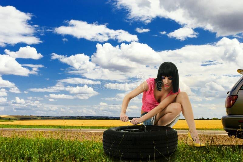 Download Young Woman Repair Car Wheel Stock Image - Image: 18636835