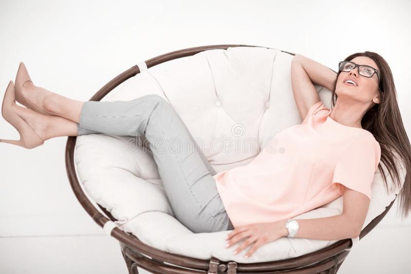 Young woman resting in a comfortable chair. stock photos