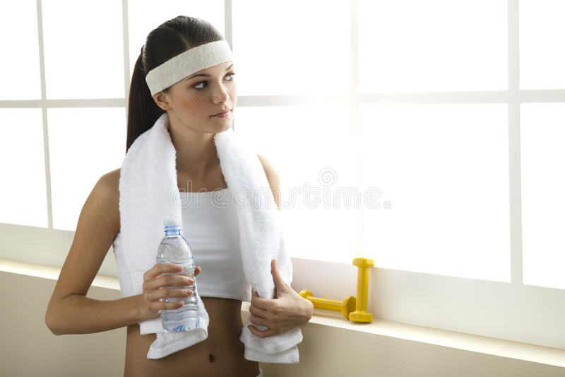 Young woman resting after excercising royalty free stock photos