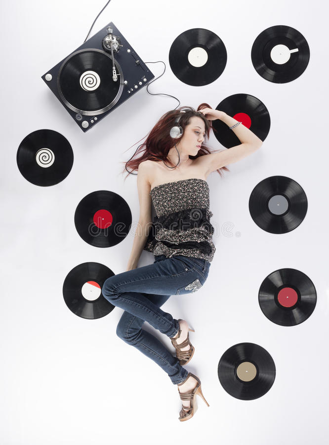 Young Woman Resting on the Floor Listening Music stock photos