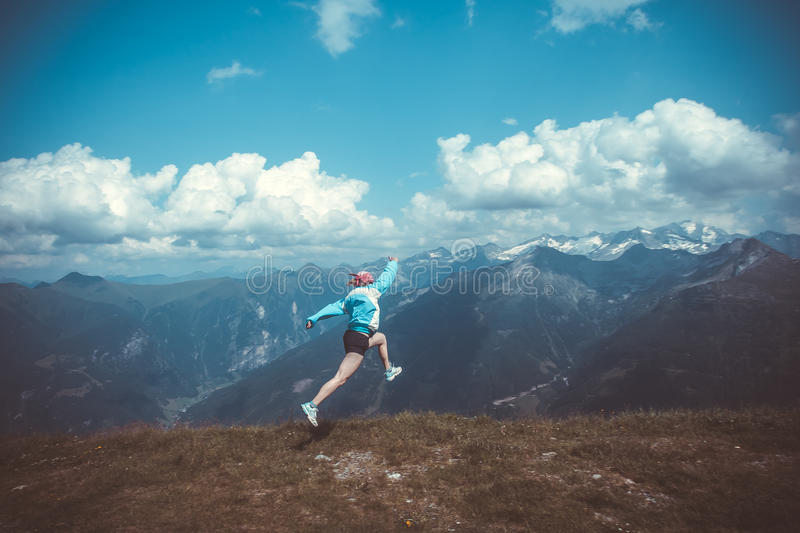 Young woman resting on a mountain hike royalty free stock images