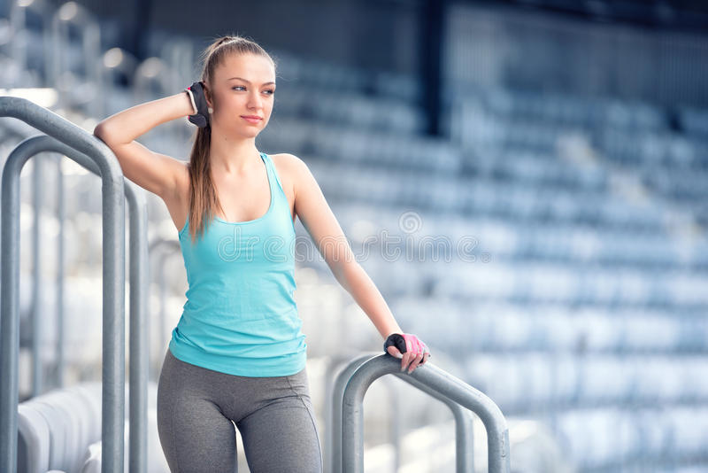 Young woman resting at training, preparing for marathon, jogging and running concept. Fitness trainer resting between sets on stock photo