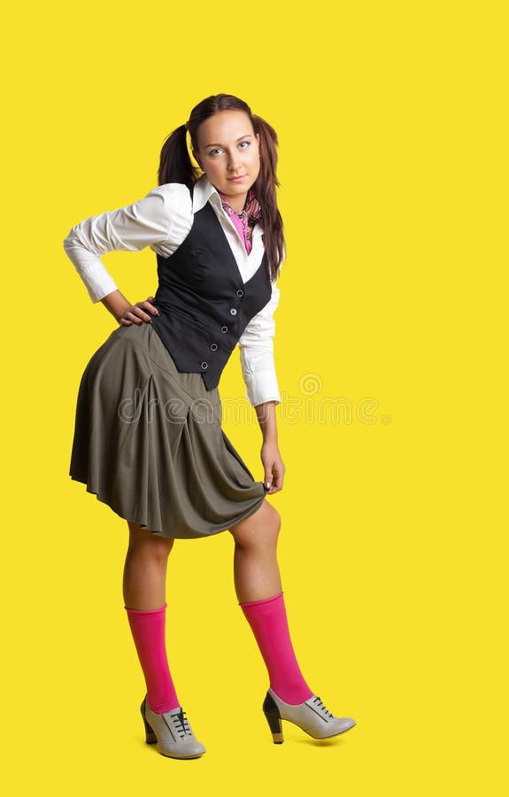 Young woman retro style cloth like school girl stock photography