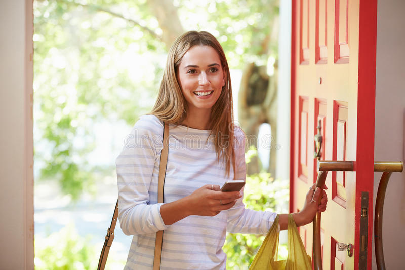 Young Woman Returning Home For Work With Shopping royalty free stock images