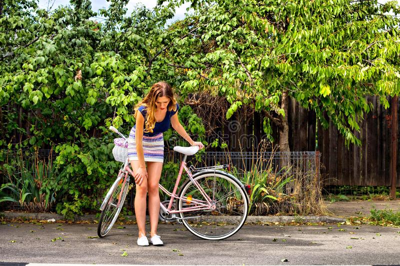 Young woman riding a bicycle stock images